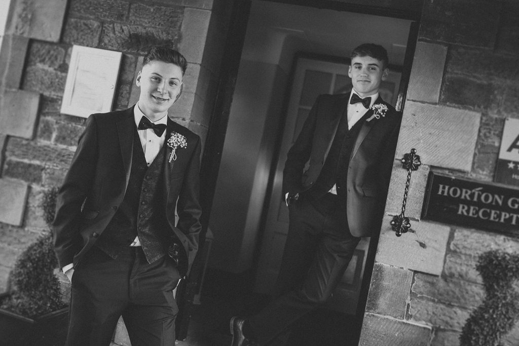 Bride & Grooms sons at the entrance to Horton Grange Hotel in Northumberland