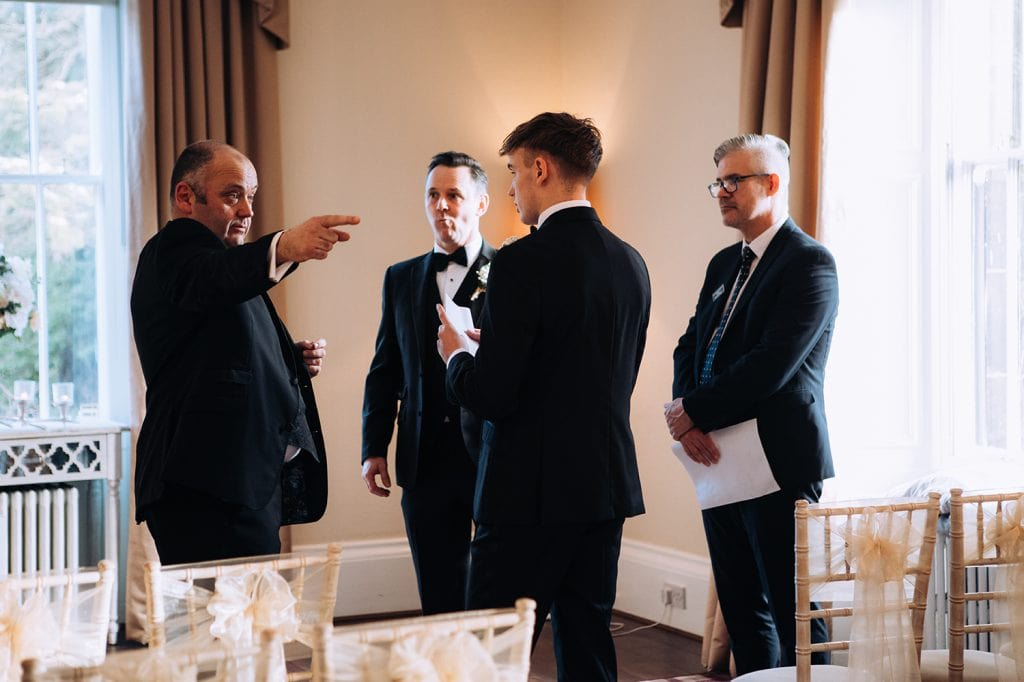 Groom giving lads instructions before the service