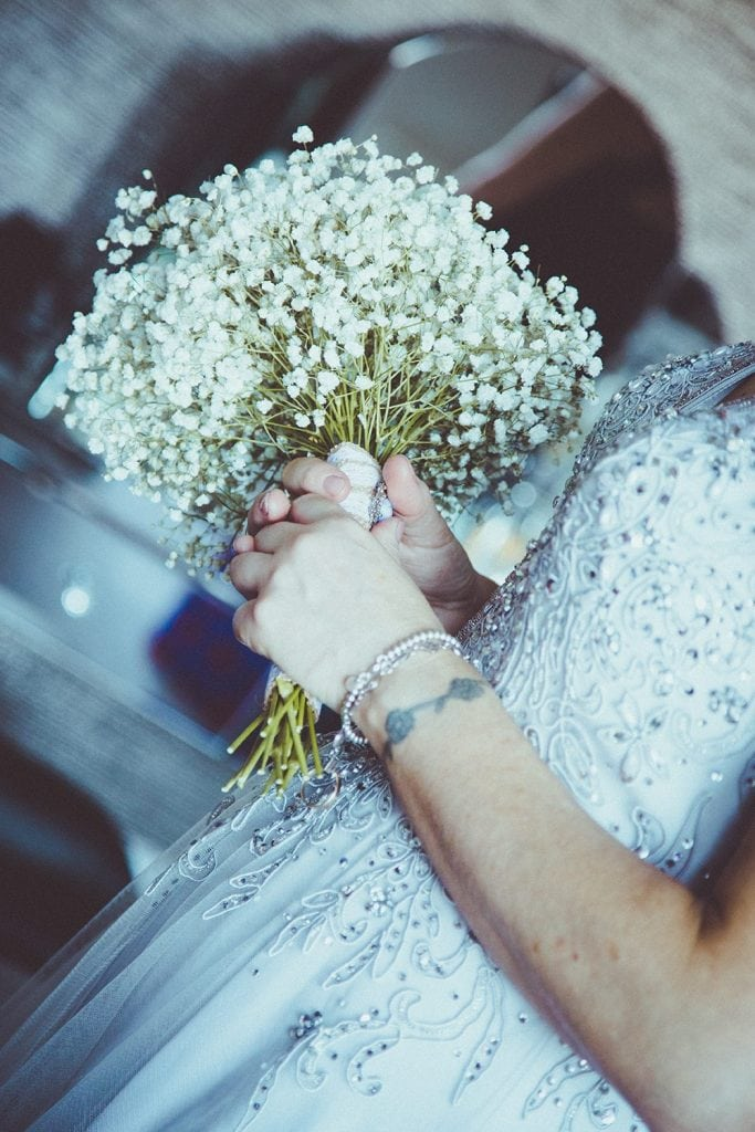 Close up of bride holding her flowers