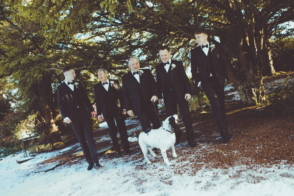 Grooms men walk the dog at Horton Grange Hotel in Northumberland
