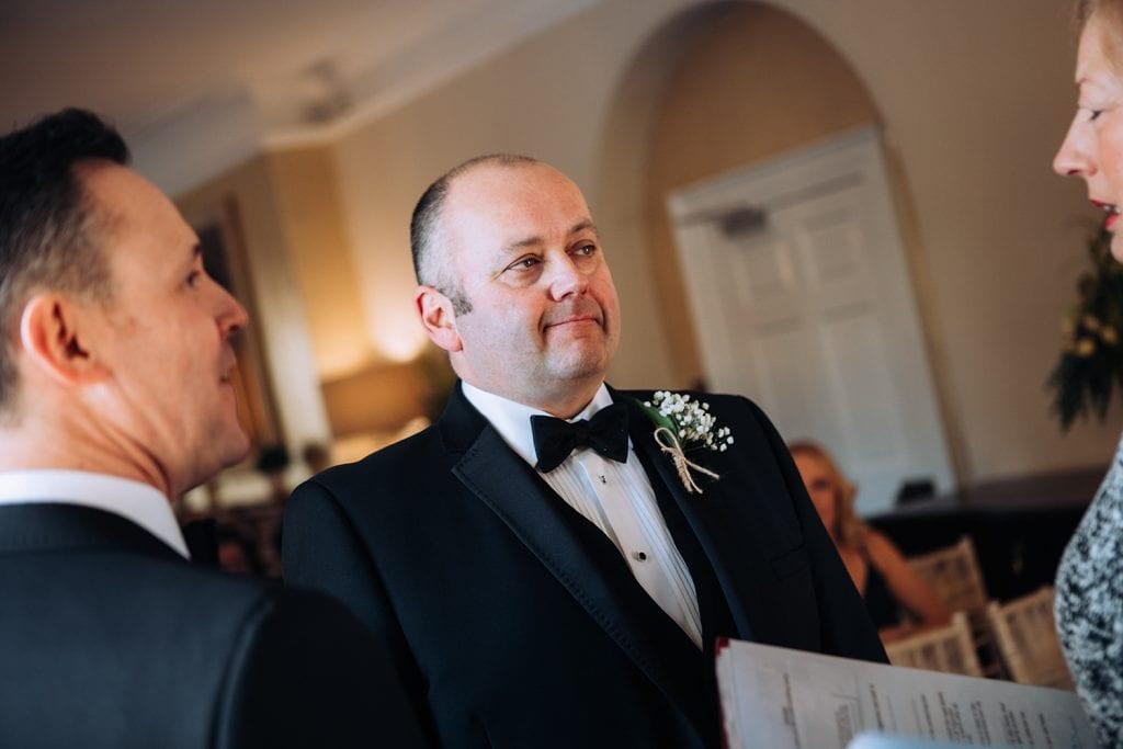 Groom talking to the registrar at Horton Grange Hotel in Northumberland