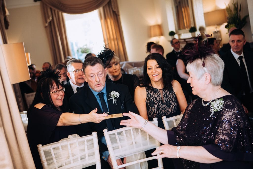 Grooms mum meeting guests at Horton Grange Hotel in Northumberland