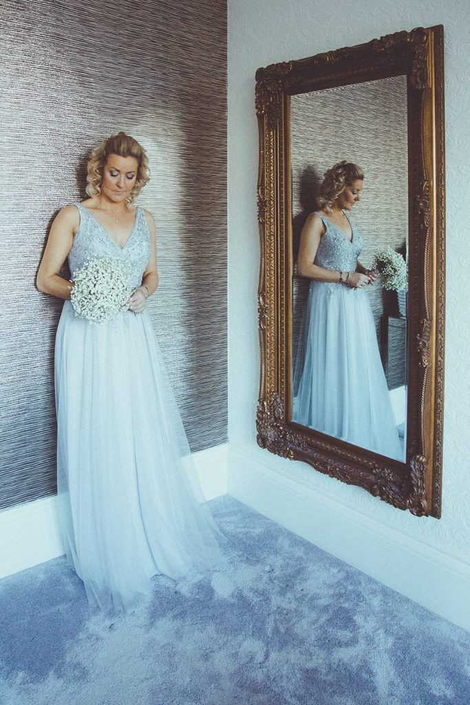 Reflection of the bride in a large mirror at Horton Grange Hotel in Northumberland