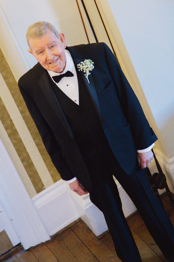 Brides father watching his daughter walk down the stairs of Horton Grange Hotel in Northumberland