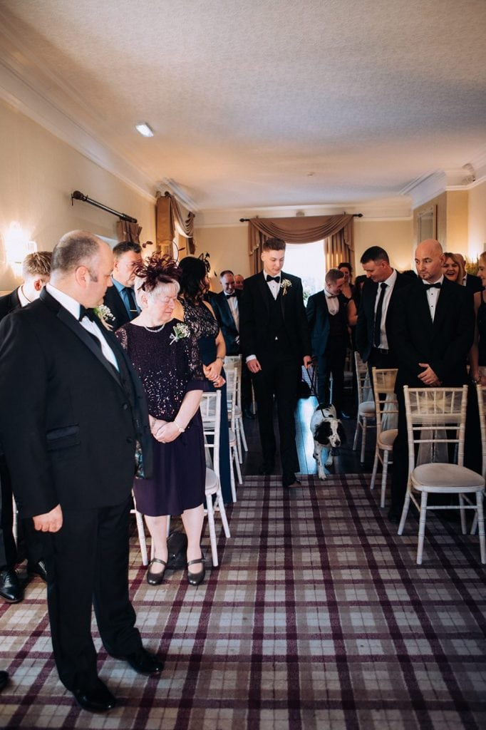 Brides son walking the family dog down the aisle at Horton Grange Hotel in Northumberland