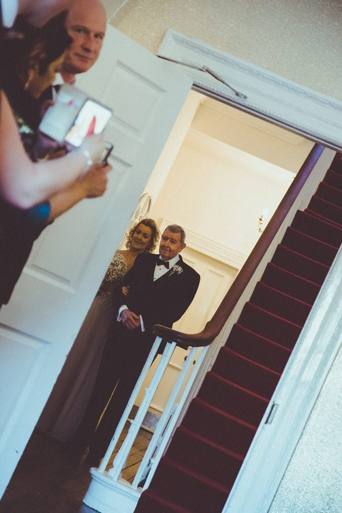 Bride waiting with her father at Horton Grange Hotel in Northumberland