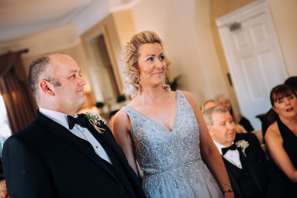Jo & Cark smiling during wedding at Horton Grange