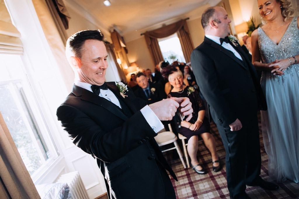Best man getting wedding rings out at Horton Grange
