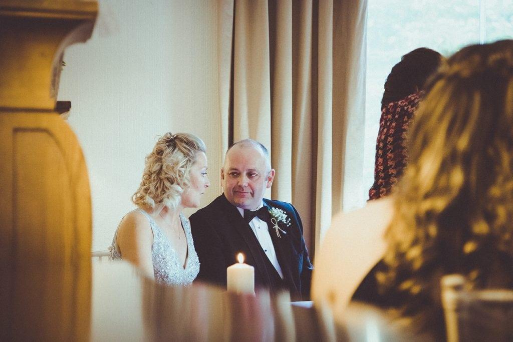 Jo & Carl talking during wedding service