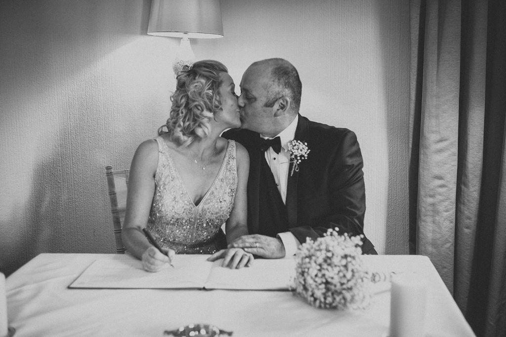 Jo & Carl Kissing after signing the register at The Horton Grange Hotel