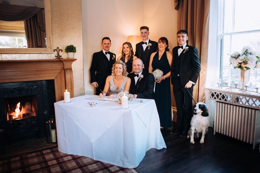 Bridal Party signing the register at Horton Grange