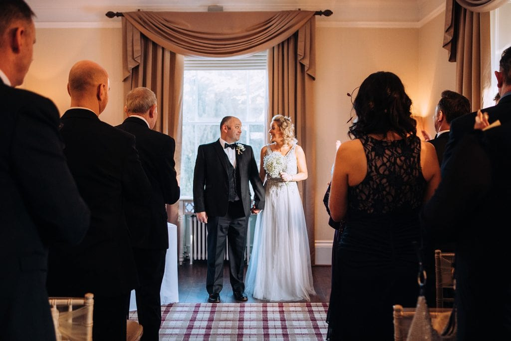 Bride & Groom waiting to walk up the aisle at The Horton Grange Hotel