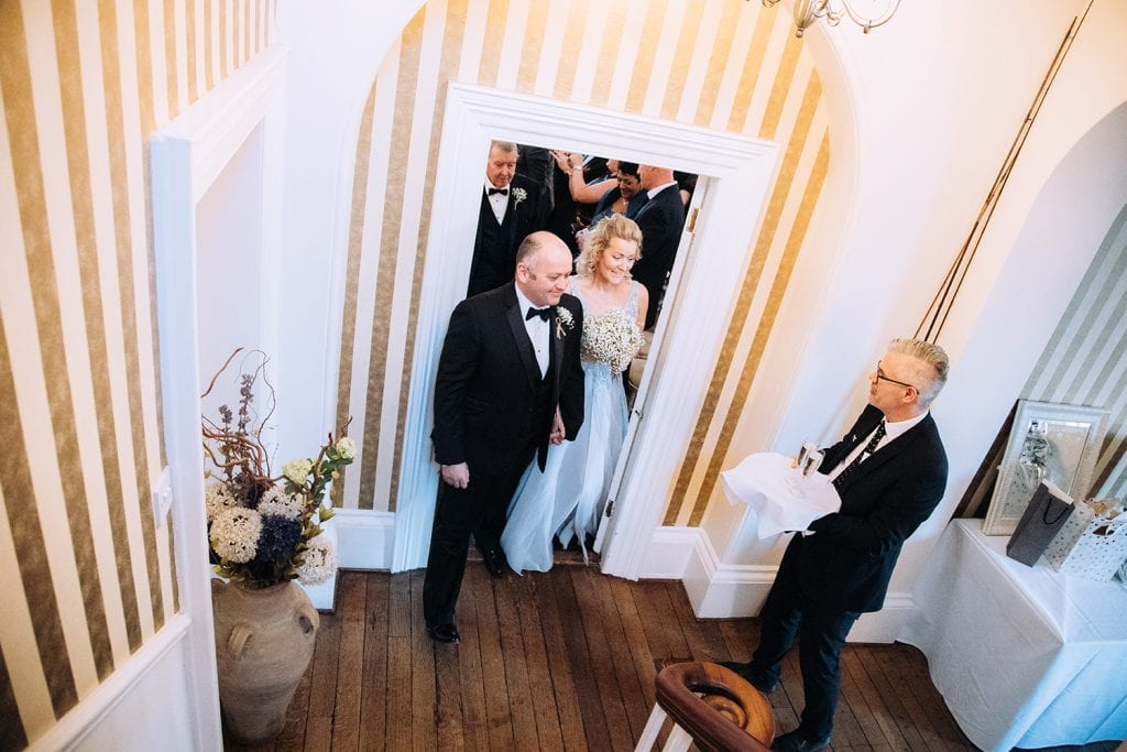 Bride & Groom greeted by drinks after their wedding at Horton Grange