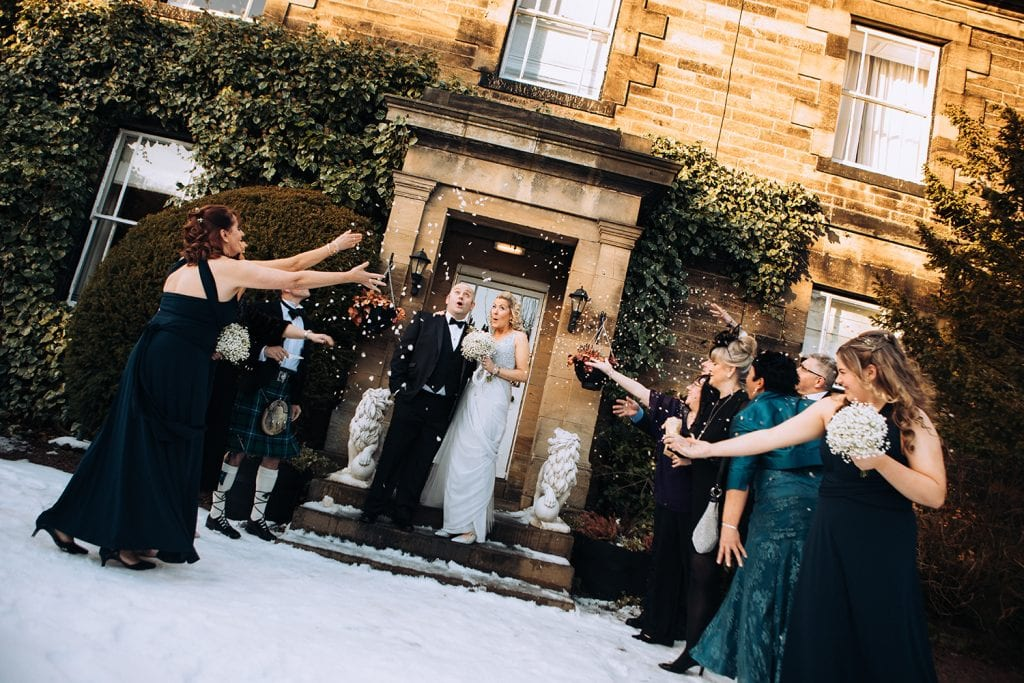 Bride & Groom being showered in confetti at Horton Grange Hotel