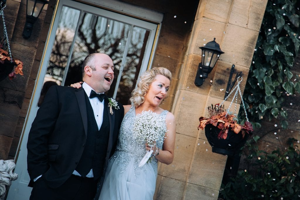 Bride & Groom laughing outside Horton Grange Hotel