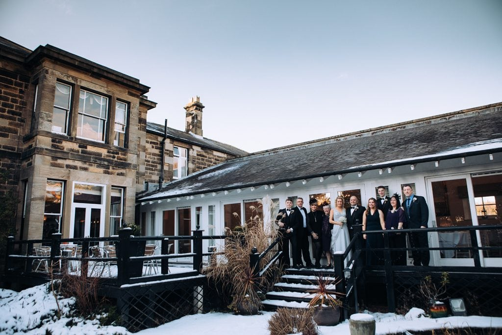 A family photo in the snow at Horton Grange Hotel