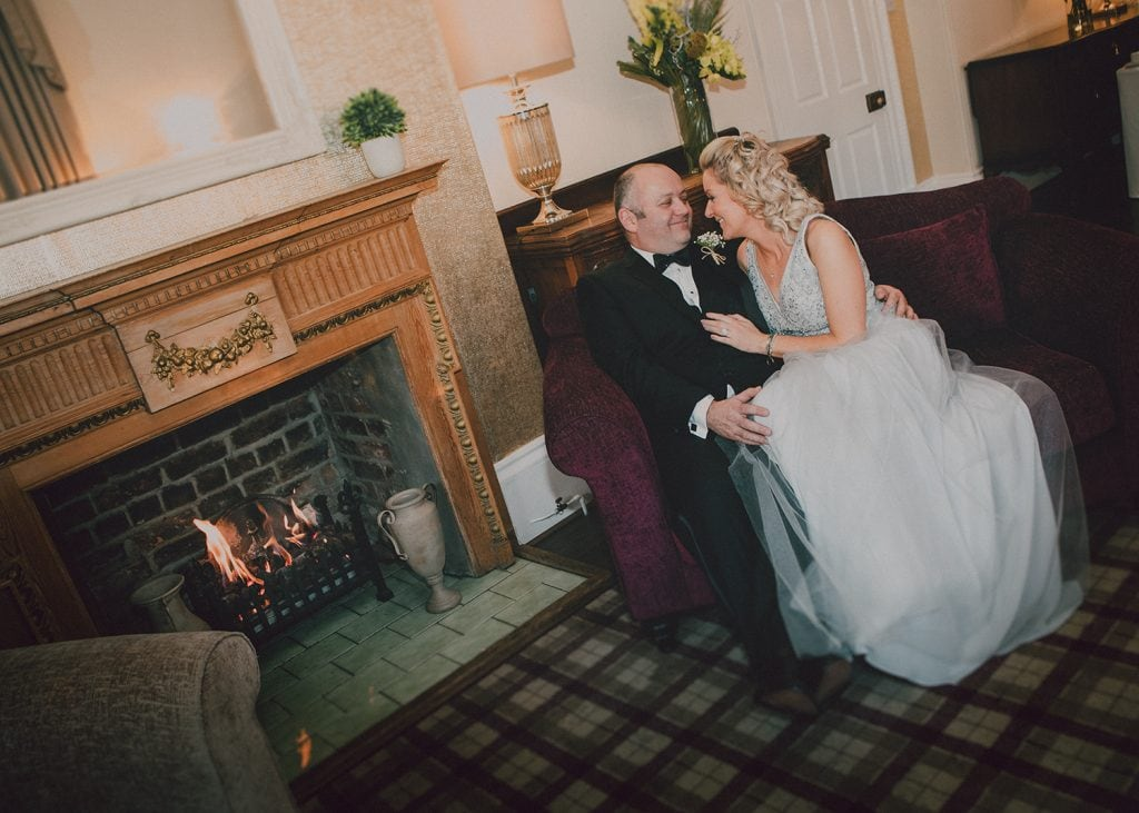 Carl & Jo enjoying the open fire at Horton Grange in Northumberland