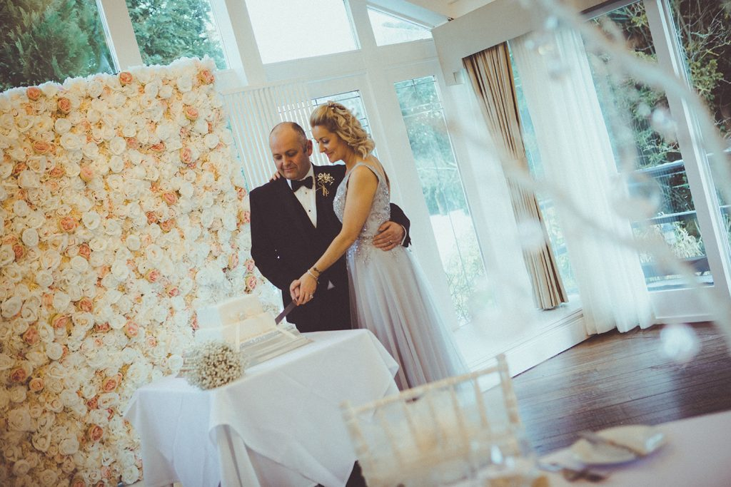 Bride & Groom cutting their cake at Horton Grange in Northumberland