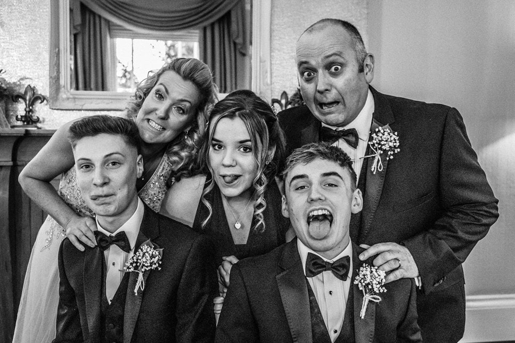The wedding party pulling faces at Horton Grange in Northumberland