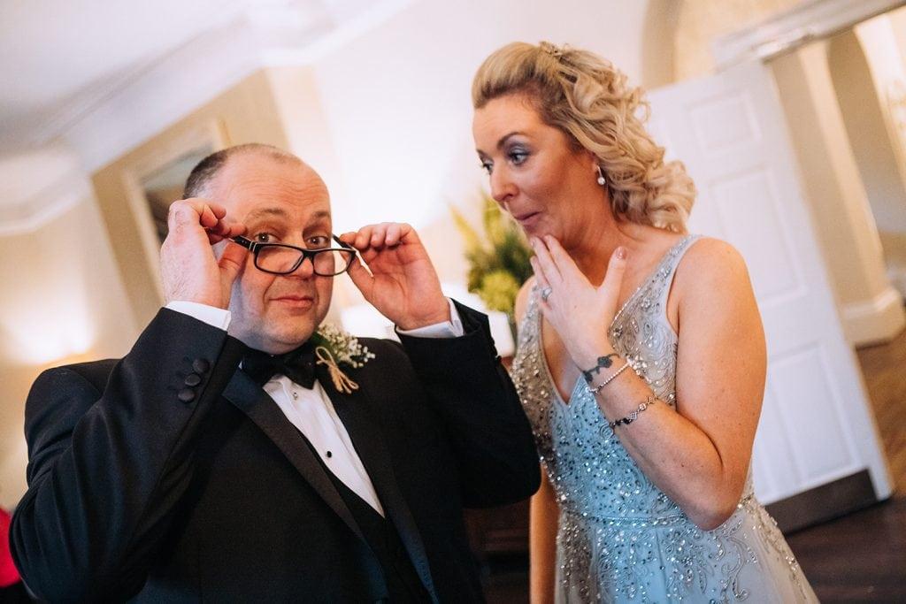 Groom hiding bestmans glasses before his speech at Horton Grange in Northumberland