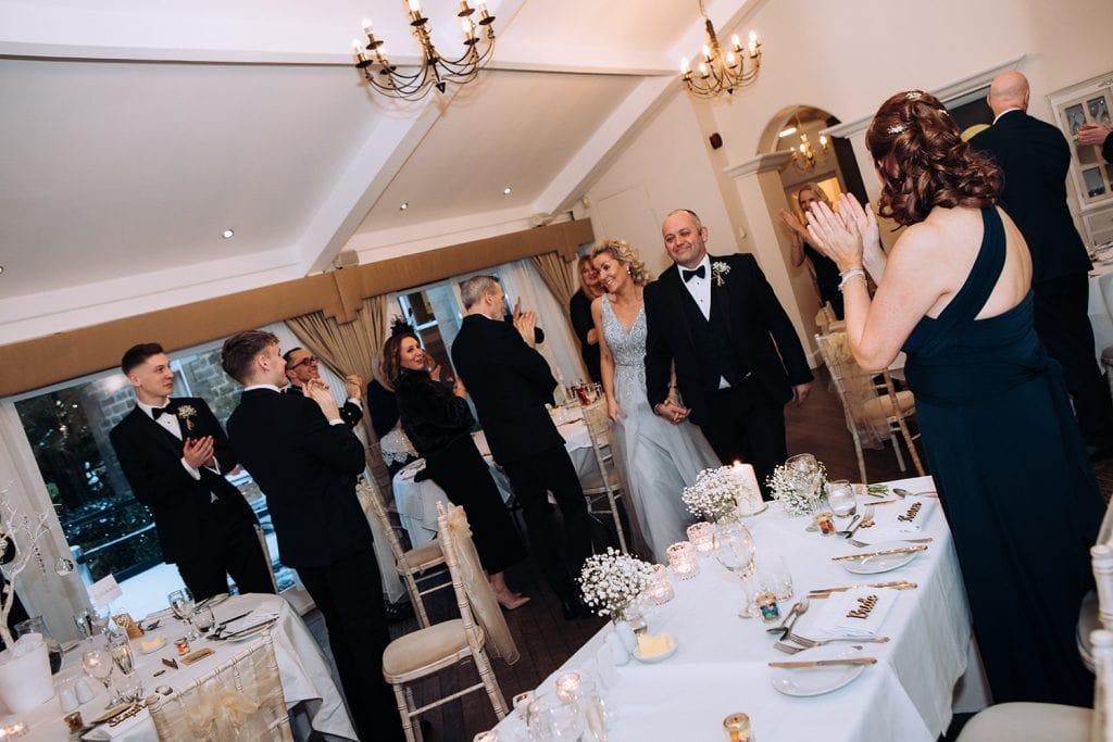 Bride & Groom walking into Horton Grange Wedding breakfast