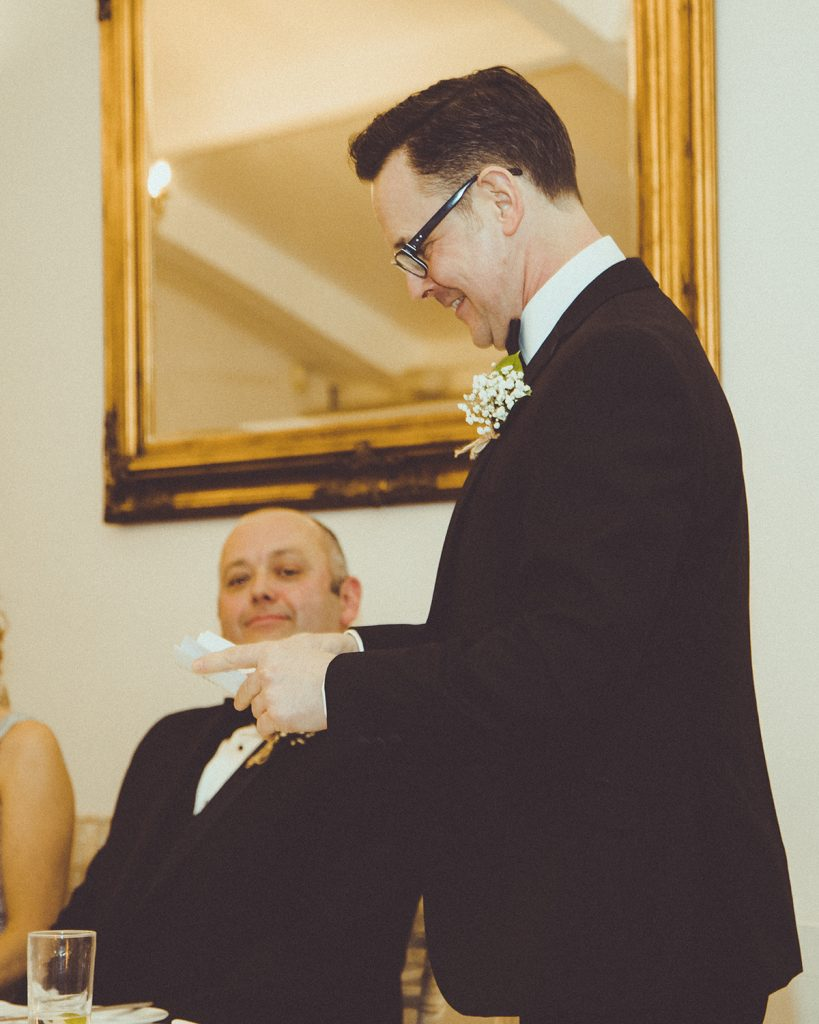 Groom watching the bestman read his speech at Horton Grange in Northumberland