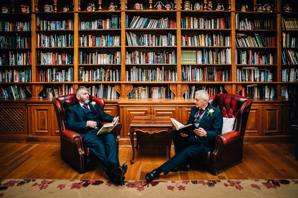 Groom & Bestman relaxing in the Library at Doxford Hall