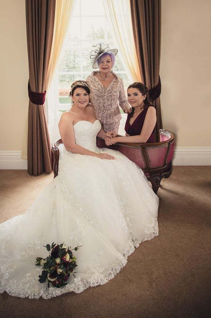 Bride, Mum & Daughter sitting in a double chaise lounge