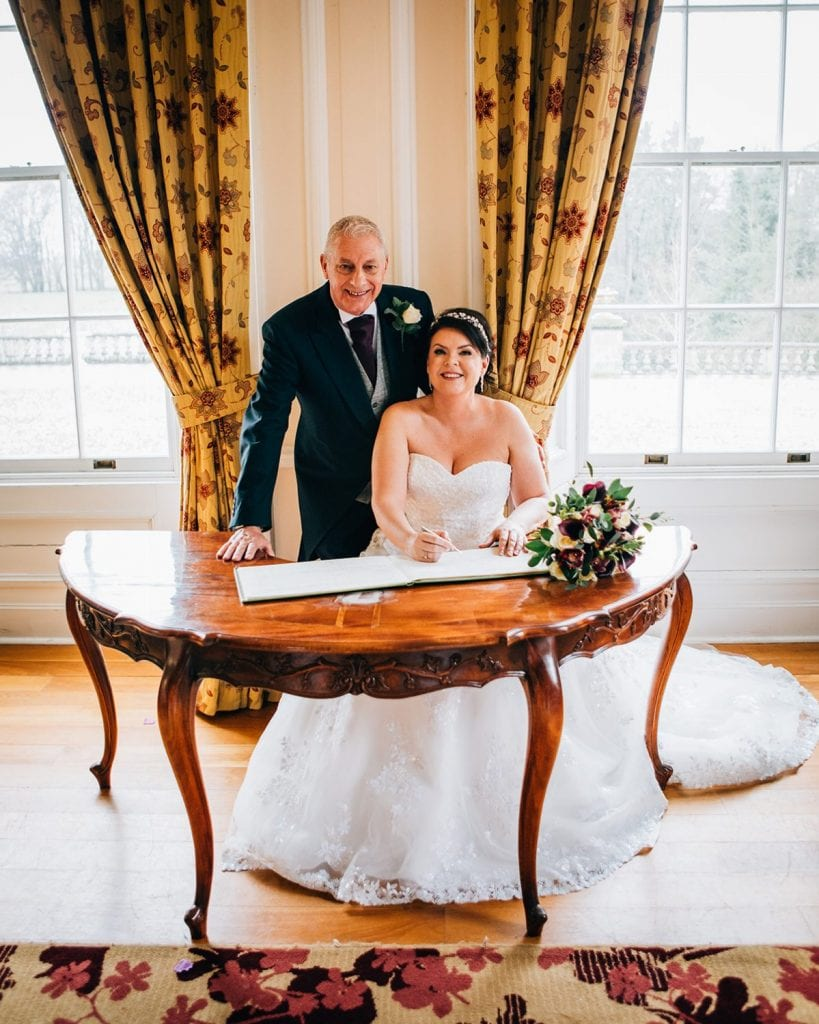 Bride & Groom signing the register at Doxford Hall