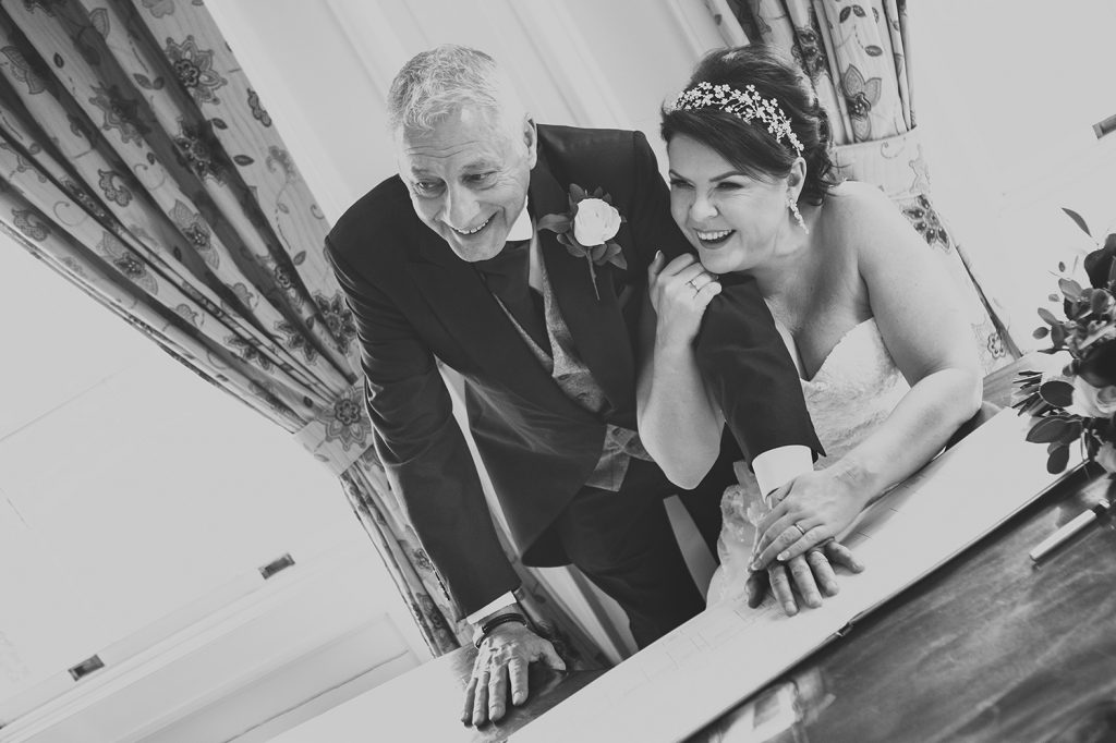 Kerry & Michael laughing after signing the register at Doxford Hall in Northumberland