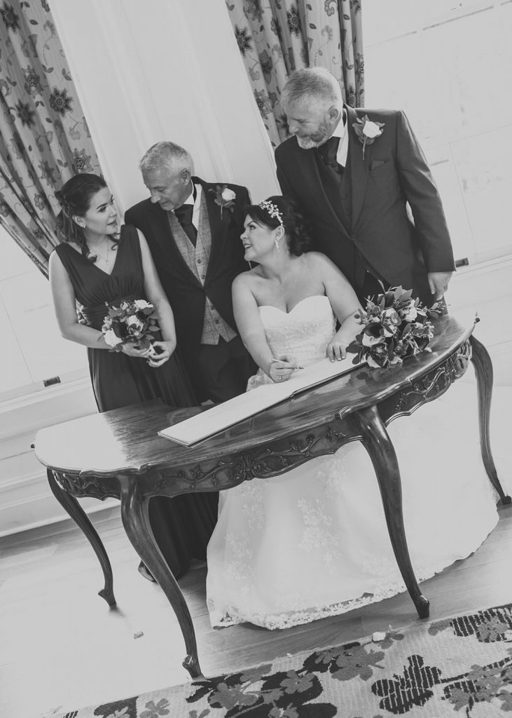 Signing the register with witnesses