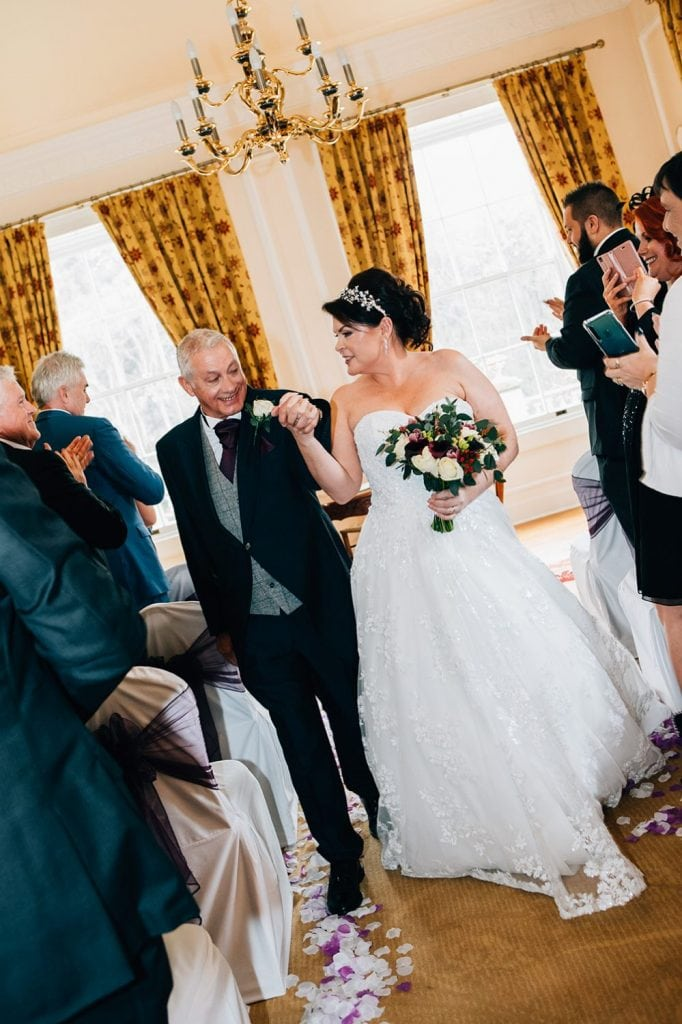Michael & Kerry walking down the aisle at Doxford Hall