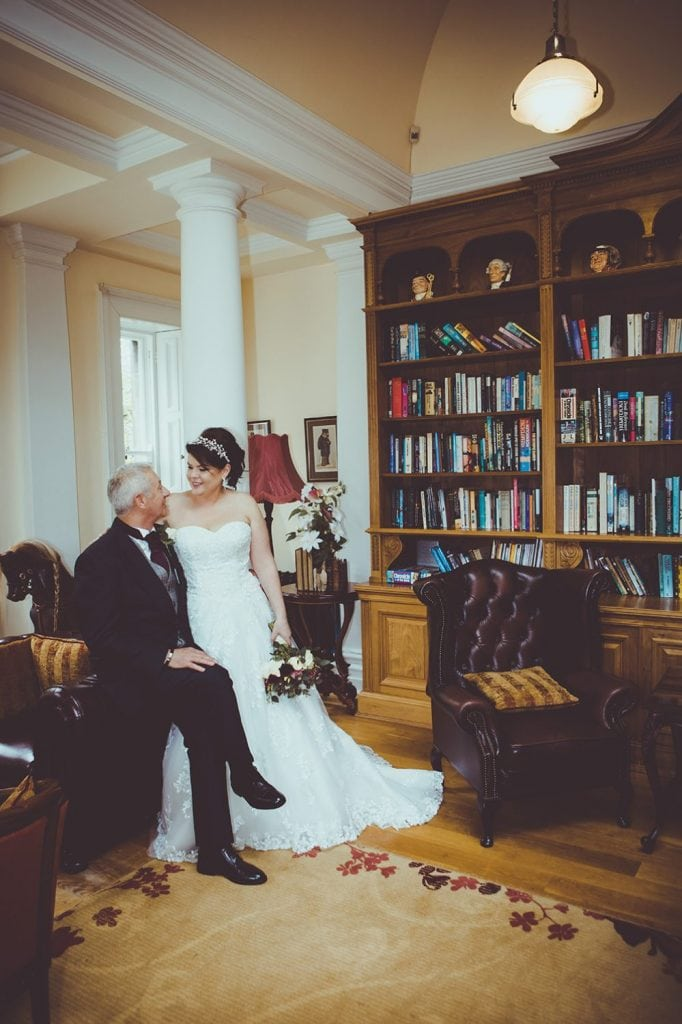 Bride & Groom relaxing in the Libary Room, Doxford Hall
