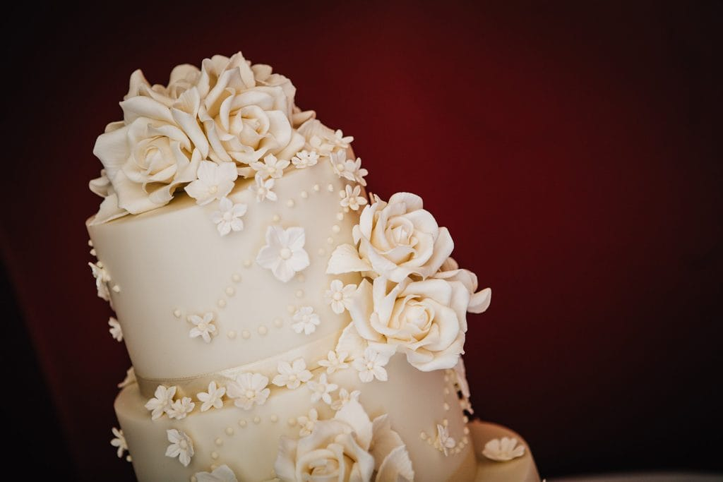 close up of a wedding Cake with rose icing