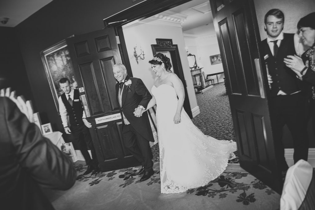 Michael & Kerry entering their wedding breakfast at Doxford Hall