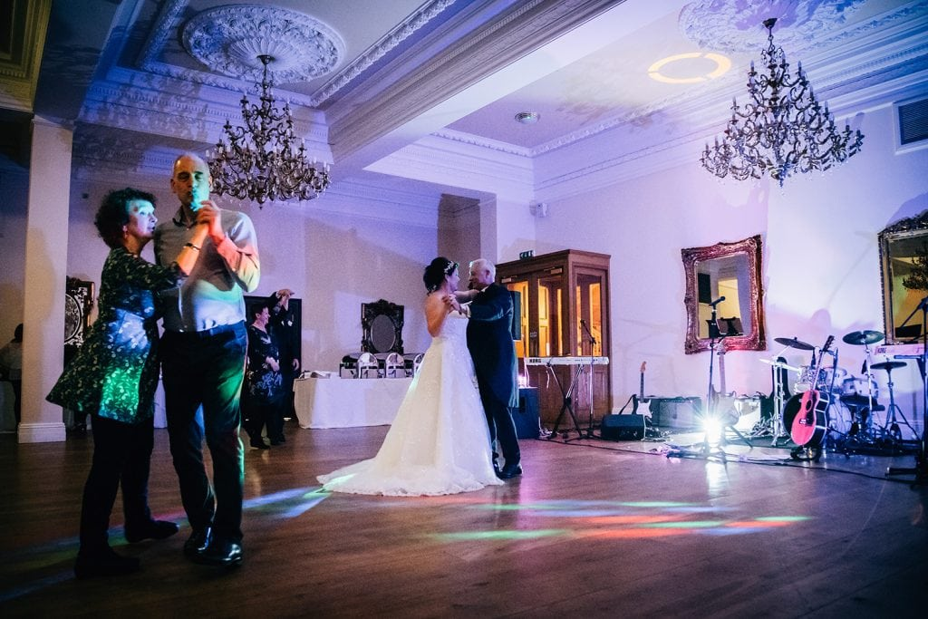 The bride & groom dancing with guests at Doxford Hall