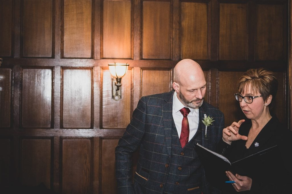 Dylan discussing the details of his wedding ceremony with the registrar