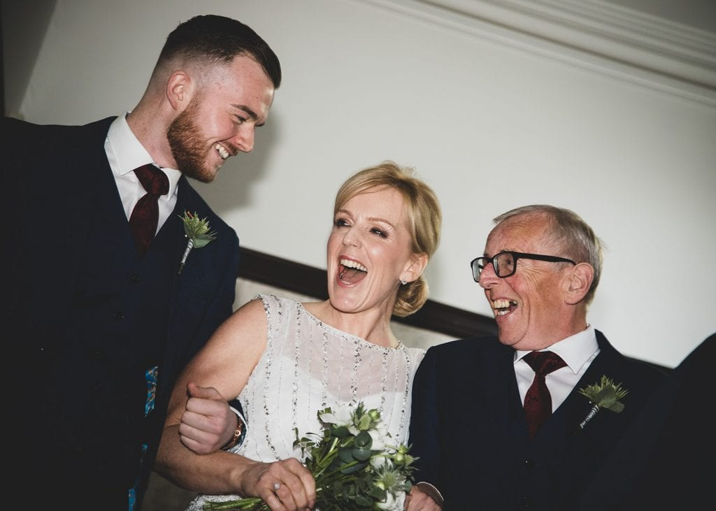 Brides laughing with her Dad and son on the landing of The Mansion House in Jesmond, Newcastle
