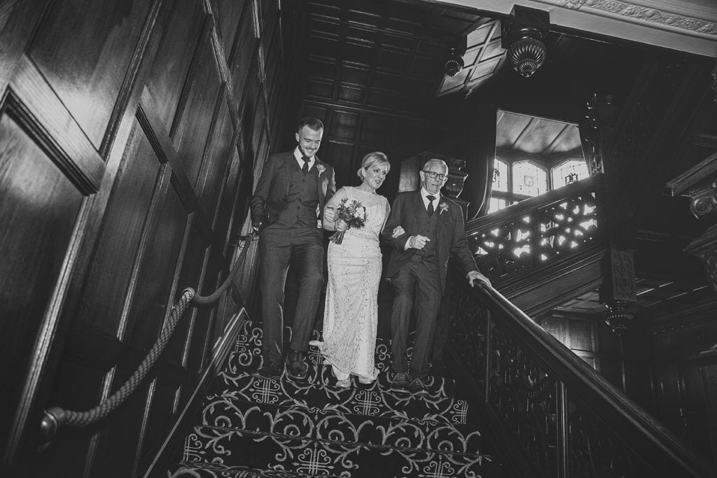 The Bride escorted down the stairs of The Mansion House in Jesmond, Newcastle
