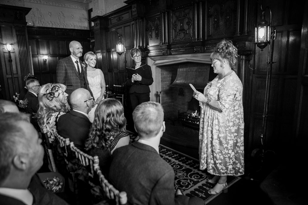 The bride, groom & guests listernin gto a reading at The Mansion House in Jesmond, Newcastle