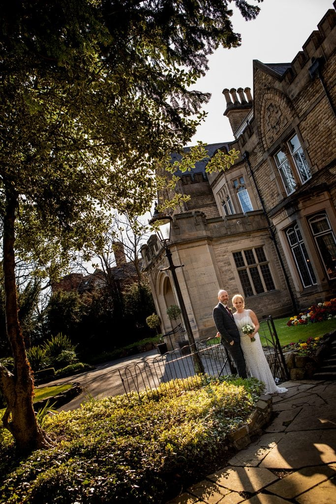The bride and groom on the garden path of The Mansion House in Jesmond, Newcastle