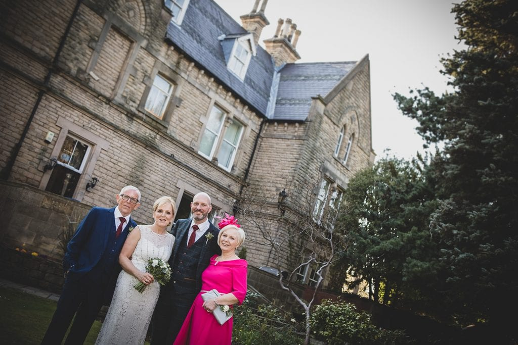 The brides family with The Mansion House in Jesmond, Newcastle in the background