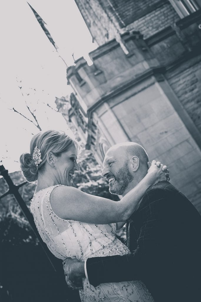 The bride & groom hugging outside of The Mansion House in Jesmond, Newcastle