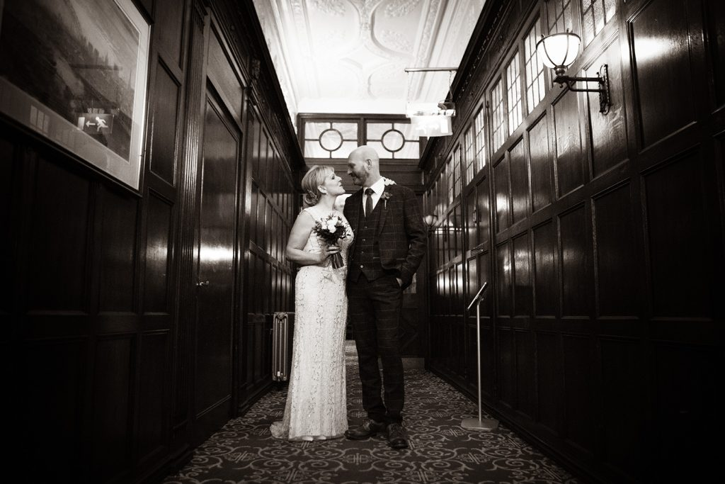 The bride & groom waiting tin a corridor at The Mansion House in Jesmond, Newcastle