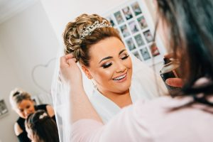 The bride laughing as she has the finishing touches to her hair at a South Shields Wedding