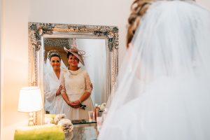 The bride and her mum looking in a mirror at a South Shields Wedding