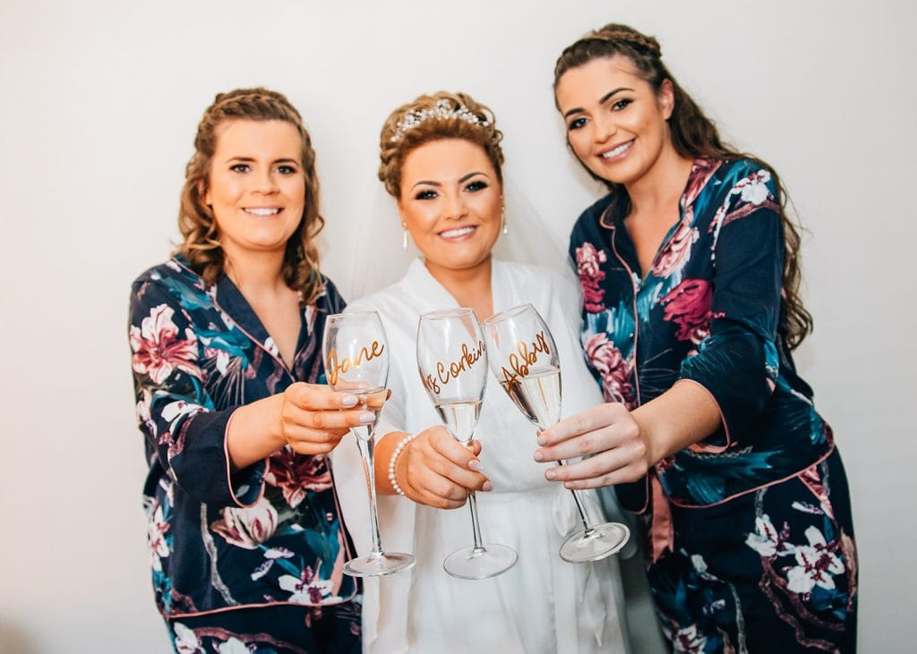Bride & her Bridesmaids holding customised champagne glasses