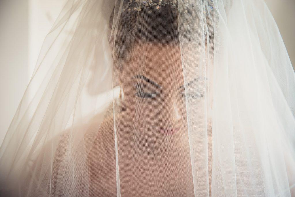 Close up of bride through her veil
