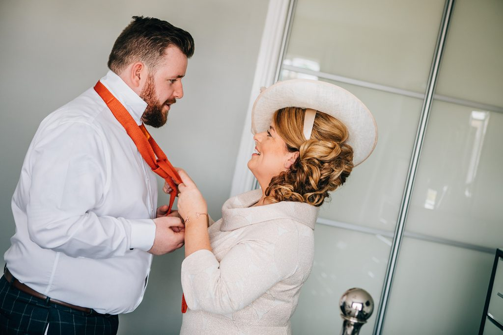 Grooms mum helping him with his tie at a South Shields Wedding