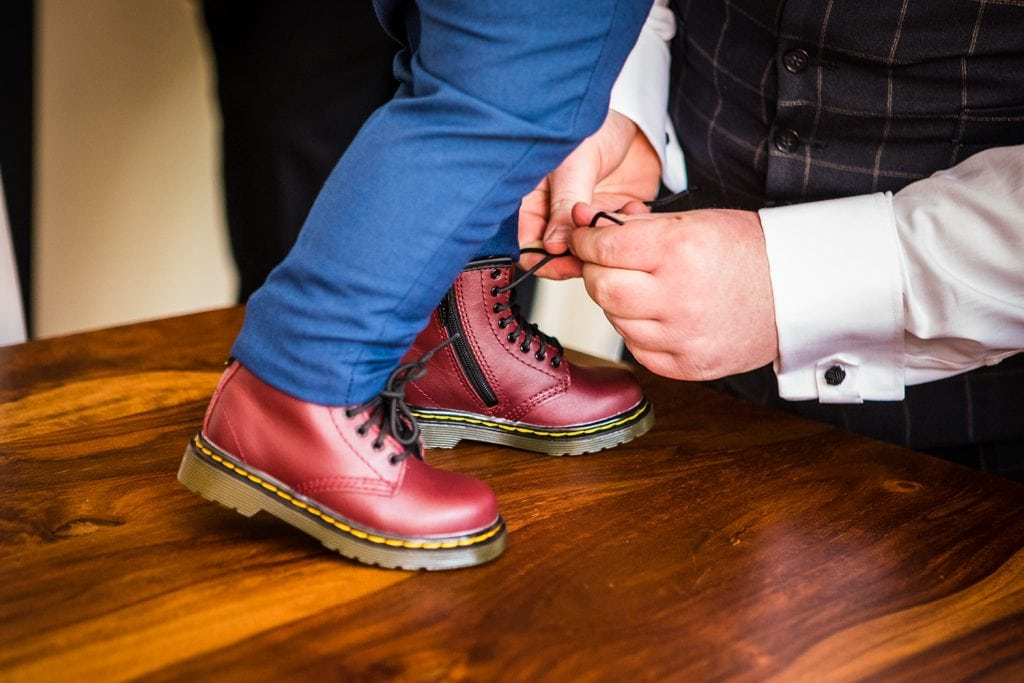 Groom tieing pageboys doc martins at a South Shields Wedding